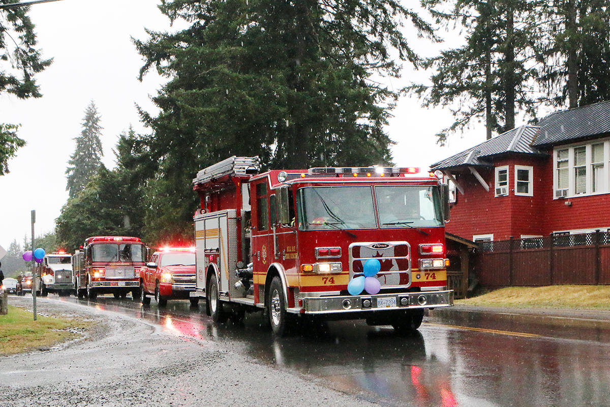 Lights flashing, fire trucks join the 'Convoy for Wilder' through Cobble Hill on Sunday, July 7. (Lexi Bainas/Citizen)
